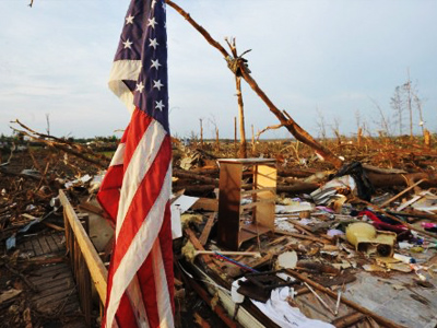 A US flag is seen next to a destroyed home in Alabama May 1, 2011 (AFP Photo / Mandel Ngan)