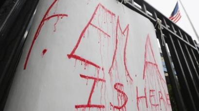A handwritten FEMA sign drips in the rain where people were waiting on line to receive 1,500 donated coats from New York Cares in the Far Rockaway neighborhood on November 13, 2012 in the Queens borough of New York City.  (Mario Tama/Getty Images/AFP)