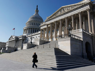 The U.S. Capitol dome is seen behind the entrance to the U.S. Senate (Reuters / Larry Downing)