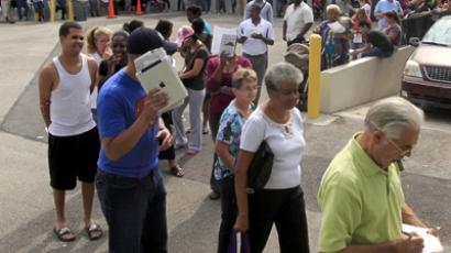 Long lines of voters are shown at the Supervisor of Elections office in West Palm Beach, Florida November 5, 2012. (Reuters / Joe Skipper)