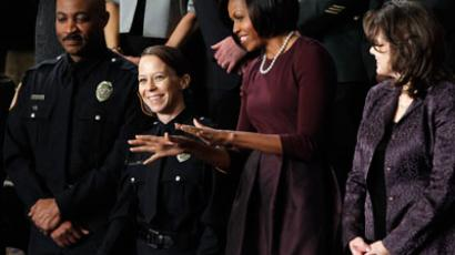 First lady Michelle Obama (2nd R) waves as she stands with Acting Fort Hood Police Chief Mark Alan Todd (L), Federal Police Officer Kimberly Munley (2nd L) and Rebecca Knerr (R) prior to U.S. President Barack Obama's State of the Union Address on Capitol Hill in Washington.(Reuters / Jason Reed)