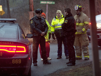 Blair County Sheriffs Deputies stand at the road block in Blair County on December 21, 2012 in Frankstown Township, Pennsylvania. (Jeff Swensen/Getty Images/AFP)