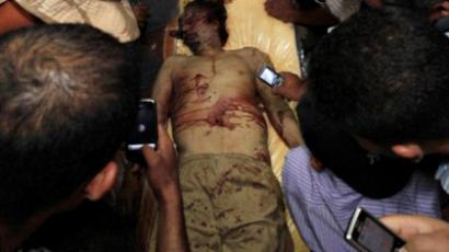 Guts but no glory: Gaddafi images over-the-top