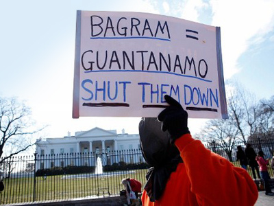 A member of Witness Against Torture holds a sign as he protests in front of the White House. (Alex Wong/Getty Images/AFP)