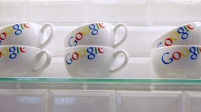 A picture shows cups with the Google logo (AFP Photo / Jacques Brinon)