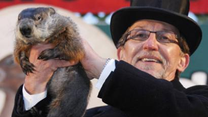 Groundhog handler Ron Ploucha holds famed weather prognosticating groundhog Punxsutawney Phil after his annual weather prediction on Gobbler's Knob in Punxsutawney, Pennsylvania, on the 126th Groundhog Day, February 2, 2012. Phil saw his shadow, signaling six more weeks of winter. (REUTERS / Jason Cohn)