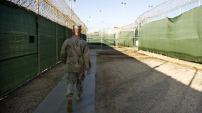 "This image reviewed by the US military shows the Commander of the Joint Detention Group walking to the ""Camp Six"" detention facility of the Joint Detention Group at the US Naval Station in Guantanamo Bay, Cuba, January 19, 2012 (AFP Photo/Jim Watson)"