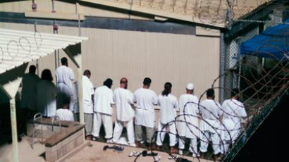 Detainees participate in an early morning prayer session at Camp IV at the detention facility in Guantanamo Bay US Naval Base (REUTERS/Deborah Gembara)