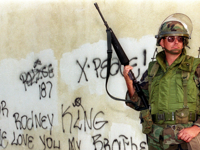 A National Guardsman stands watch in front of a graffiti covered wall (Reuters / Lee Celano)