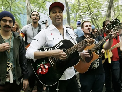 Tom Morello (C) of the rock band Rage Against the Machine marches with Occupy Wall Street demonstrators during a May Day rally on May 1, 2012 in New York City. (Monika Graff/Getty Images/AFP)