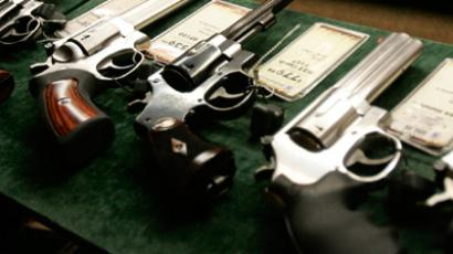 Guns are seen inside a display case at the Cabela's store in Fort Worth. (REUTERS/Jessica Rinaldi)