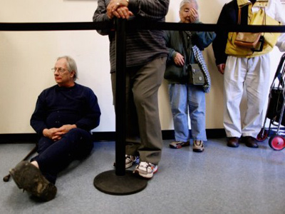 Rick, who did not want to give his last name, waits in line with others to collect 70 pounds of perishable and non-perishable food at the Manna Food Center in Gaithersburg, Maryland (Chip Somodevilla / Getty Images / AFP)
