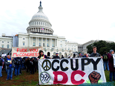 Occupy DC protesters holds a signs January 17, 2012 during a demonstration in front of the Capitol in Washington, DC. (AFP Photo / Karen Bleier)