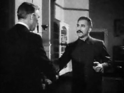 "An actor playing Joseph Stalin greets the U.S. ambassador in a scene from ""Mission to Moscow"" (Warner Brothers, 1943)"