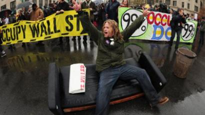Occupy protesters block the intersection at 15th and K Streets in Washington, DC December 7, 2011 (AFP Photo / Karen BLEIER)