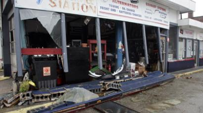 The damaged front of an auto repair shop on Atlantic Avenue is seen in the aftermath of Hurricane Sandy's landfall in Atlantic City, New Jersey, October 30, 2012.  (Reuters / Tom Mihalek)