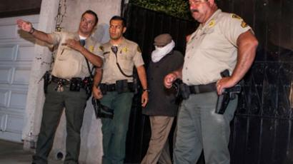 Nakoula Basseley Nakoula (2nd R) is escorted out of his home by Los Angeles County Sheriff's officers in Cerritos, California.(Reuters / Bret Hartman)