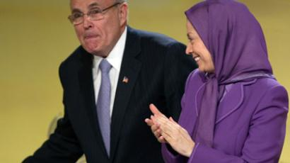 Maryam Rajavi (R), President-elect of the National Council of Resistance of Iran (NCRI), the political winf of the MEK, applauds the arrival of former New York City Mayor Rudy Giuliani during a conference about Camp Ashraf in Paris. (Reuters / Charles Platiau)