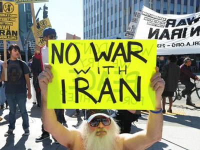 "Demonstrators hold placards and shout slogans during a ""No War on Iran"" protest in Los Angeles, California, on February 4, 2012. (AFP Photo / Frederic J. Brown)"