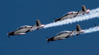 Israeli Air Force T-6A Texan aircraft fly in formation during a display for Israel's 64th Independence Day over Jerusalem April 26, 2012 (Reuters/Amir Cohen)