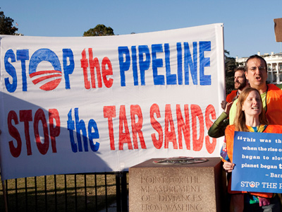Demonstrators call for the cancellation of the Keystone XL pipeline during a rally in front of the White House in Washington. (REUTERS/Joshua Roberts)