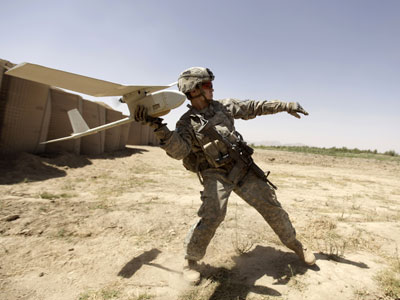 A US army soldier with the 101st Airborne Division Alpha Battery 1-320th tries to launch a drone outside Combat Outpost Nolen in the village of Jellawar in The Arghandab Valley.(AFP Photo / Patrick Baz)