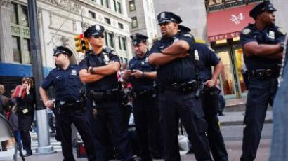 Police stand guard against demonstrators opposed to corporate profits on Wall Street during a march in the Financial District on September 26, 2011 New York City. (Spencer Platt/Getty Images/AFP )