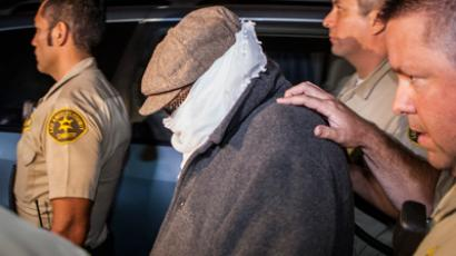 Nakoula Basseley Nakoula (C) is escorted out of his home by Los Angeles County Sheriff's officers in Cerritos, California September 15, 2012 (Reuters / Bret Hartman)
