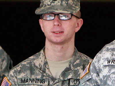 Bradley Manning is escorted from the courthouse at Fort Meade, Maryland after closing arguments in his Article 32 hearing December 22, 2011 (Reuters / Yuri Gripas)