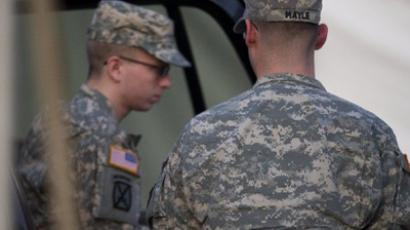 US Army Private First Class Bradley Manning (L), surrounded by US military, arrives at a US military Magistrate Court facility during an Article 32 hearing at Fort Meade, Maryland on December 19, 2011 (AFP Photo / Jim Watson)
