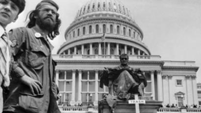 United States, Washington : Veterans of the war in Vietnam take part in the protest by piling their medals, decorations and awards in a trash set down for the purpose in front of the Capitol during a demonstration against the Vietnam war in Washington 26 April 1971. A veteran places his army helmet on the pile of decorations. (AFP Photo)