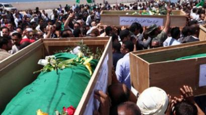 Libya, Tripoli: Mourners take part in the funeral of people killed on May 13, during a NATO air strike on the eastern city of Brega, at the Martyr's cemetery in Tripoli on May 14, 2011. (AFP Photo / Mahmud Turkia)