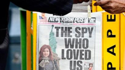 A New York newspaper is on display featuring a personal photo of suspected Russian spy Anna Chapman at a news stand in New York (AFP Photo / Emmanuel Dunand)