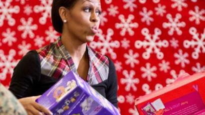 Washington: US First Lady Michelle Obama delivers toys and gifts donated by Executive Office staff to the Marine Corps' Toys for Tots campaign at Joint Base Anacostia-Bolling in Washington. (AFP Photo/Nicholas Kamm)