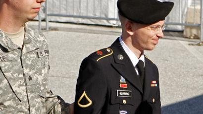 Army Private First Class Bradley Manning is escorted in handcuffs, for his motion hearing at the courthouse in Fort Meade in Maryland (Reuters / Jose Luis Magana)