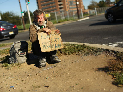 A homeless man named Bob waits for donations from passing motorists.(AFP Photo / Spencer Platt)