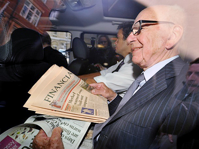 News Corporation Chief Rupert Murdoch is seen through his car window as he leaves his London  home on July 15, 2011 (AFP Photo / Getty Images)