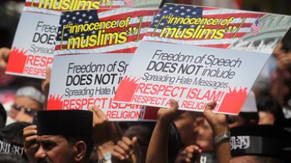 Malaysian Muslims hold placards and shout anti-American slogans during a protest against the low-budget US film the 'Innocence of Muslims' and the cartoon of Prophet Mohammad in a French weekly in Kuala Lumpur on September 21, 2012. (AFP Photo/Str)