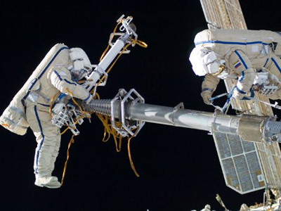 Cosmonaut participate in a session of extravehicular activity (EVA) to continue outfitting the International Space Station (AFP Photo / NASA)