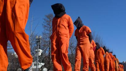 "Members of the group ""Witness Against Torture"" dressed in orange prison jumpsuits protest against the detention camp at Guantanamo Bay, along Pennsylvania Avenue in Washington D.C.(Reuters / Larry Downing)"