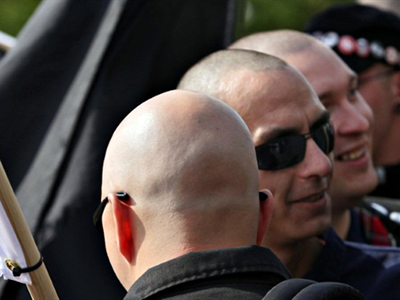 Germany, Berlin : Neo-Nazi skinheads take part in a right-wing rally in Berlin on May 1, 2010. (AFP Photo / David Gannon)