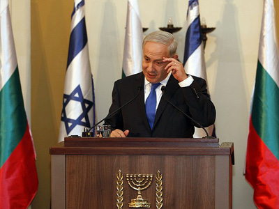 Israeli Prime Minister Benjamin Netanyahu gestures during a joint press conference with his Bulgarian counterpart Boyko Borisov (bot seen) in Jerusalem on September 11, 2012. (AFP Photo/Gali Tibbon)