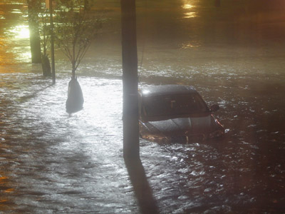 Floodwaters surround a car parked on a street in Hoboken, New Jersey October 29, 2012. (Reuters/Gary Hershorn)