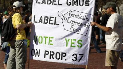 Two demonstrators hold a sign during a rally in support of the state's upcoming Proposition 37 ballot measure in San Francisco, California October 6, 2012. (Reuters/Stephen Lam)