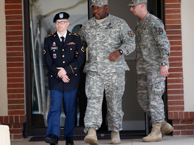 Army Pfc. Bradley Manning (L) leaves the courthouse after his motion hearing at Fort Meade in Maryland March 15, 2012 (Reuters / Jose Luis Magana)