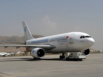 Kabul : This picture taken on September 18, 2011, shows an Ariana passenger plane parking on the runway at the Kabul International airport. (AFP Photo / Adek Berry)