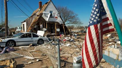 A house at 121 Kissam Ave is seen with its entire first floor washed away, as well as the entire surrounding area demolished when Hurricane Sandy hit the coastal estuary in the Oakwood Beach area of Staten Island, New York, November 6, 2012.(AFP Photo / Paul J. Richards)
