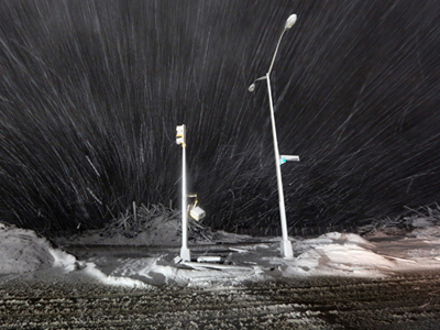 Snow blows past debris and nonfunctioning streetlights during a Nor'Easter snowstorm on November 7, 2012 in the Rockaway neighborhood of the Queens borough of New York City (Mario Tama / Getty Images / AFP)