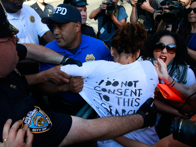A woman is taken into custody by the police following a protest in New York (Reuters / Eric Thayer)