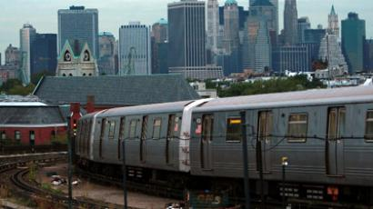 A subway heads into Manhattan in New York City. (AFP Photo / Spencer Platt)
